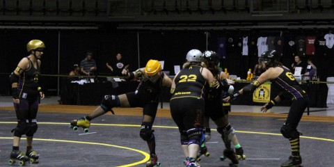 The Appalachian Rollergirls work through their pre-game warm up routine.