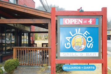 Galileo's Grill and Bar uses a phone application scanner to check customers' IDs before entering. Owner Mark Dickson said Galileo staff usually catch six to seven underaged customers using fake IDs per week. Photo by Gerrit van Genderen  |  The Appalachian
