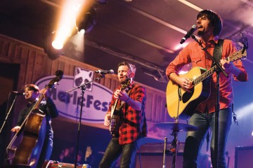 Avett Brothers frontmen Bob Crawford (left), Scott Avett and Seth Avett perform on The Doc and Merle Watson Stage on Saturday night at MerleFest, an annual bluegrass festival that takes place on the campus of Wilkes Community College. Photo by Paul Heckert  |  The Appalachian