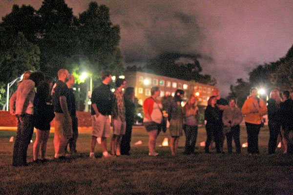 Students gather on Duck Pond Field to commemorate the recent passing of fellow student Paige Kriegel. The students organized and held a candlelight vigil, sang songs and shared memories in Kriegel's honor. Maggie Cozens | The Appalachian