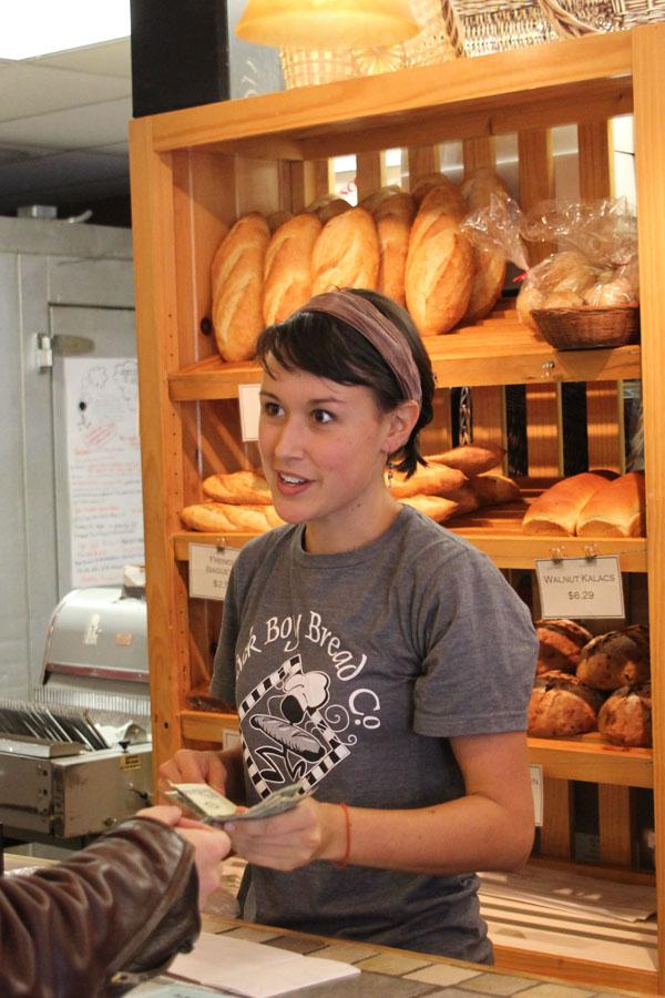 Junior Hailey Moore accepts money for an order at Stick Boy Bread Co. on Thursday morning. The bakery has been in Boone for 11 years and regularly donates to charities, non profits and churches in the area. Paul Heckert | The Appalachian