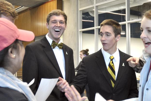 Presidential elect Dylan Russell (left) and vice presidential running mate Michael Page (right) celebrate while reading the offical results of the SGA elections Tuesday. Justin Perry | The Appalachian