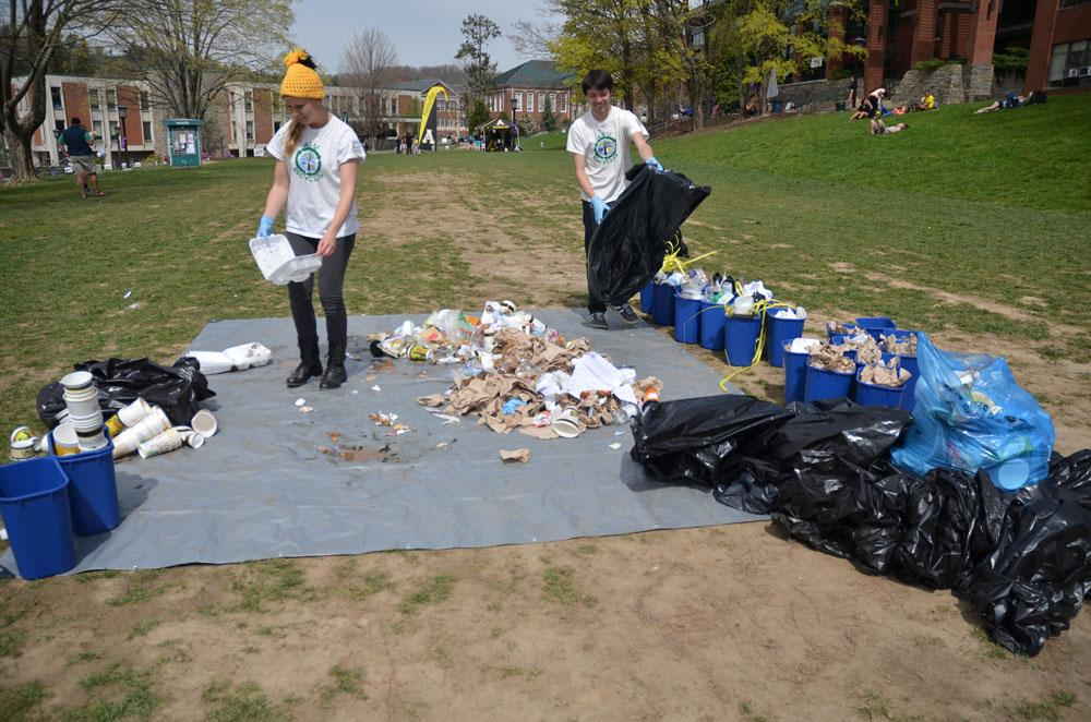 Zero Waste volunteers Christie Horowski and Corie Wallen organize bags of trash into recyclables, trash and compostable materials. They organized 24 bags of trash down to only one bag of trash, the rest being recyclable or compostable. Nicole Debartolo | The Appalachian