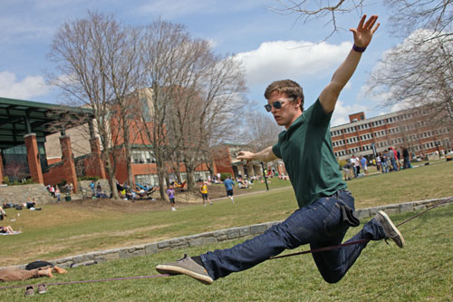 Sophomore recreation management major Matt Edwards takes advantage of the warm weather and slacklines on Sanford Mall on Monday afternoon. Tempuratures are expected to rise in the 70s Tuesday and Wednesday. Paul Heckert | The Appalachian