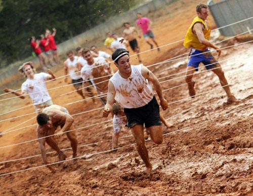 Junior exercise science major Trevor Thomas makes a break from an obstacle in Sunday's Alpha Delta Pi-sponsored Mud Run held at the High Country Fairgrounds. The run raised $4,872 for the Ronald McDonald House and had 375 participants. Paul Heckert | The Appalachian