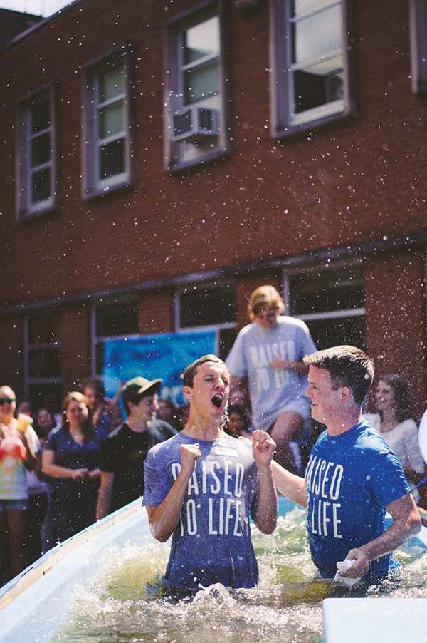Sophomore recreation management major Weston Lawrence (left) celebrates after being baptized at Elevation Church on Sept. 22. Elevation has an average attendance of 350 students each Sunday. Photo courtesy of Erica Serrano.