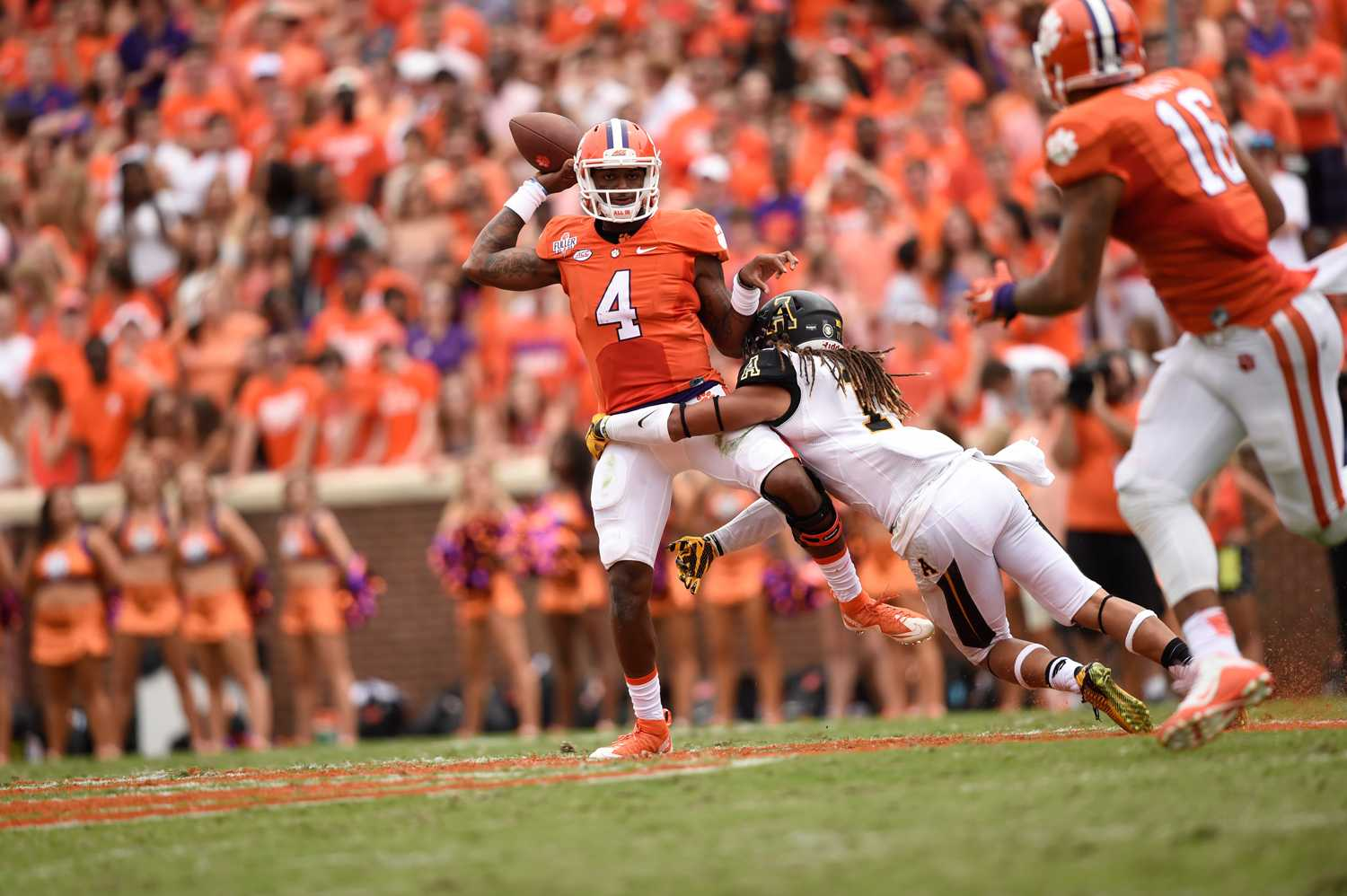 Sophomore linebacker Devan Stringer attempts to take down Clemson quarterback Deshaun Watson. The Tigers defeated the Mountaineers 41-10 Saturday.  Photo by Justin Perry  |  The Appalachian