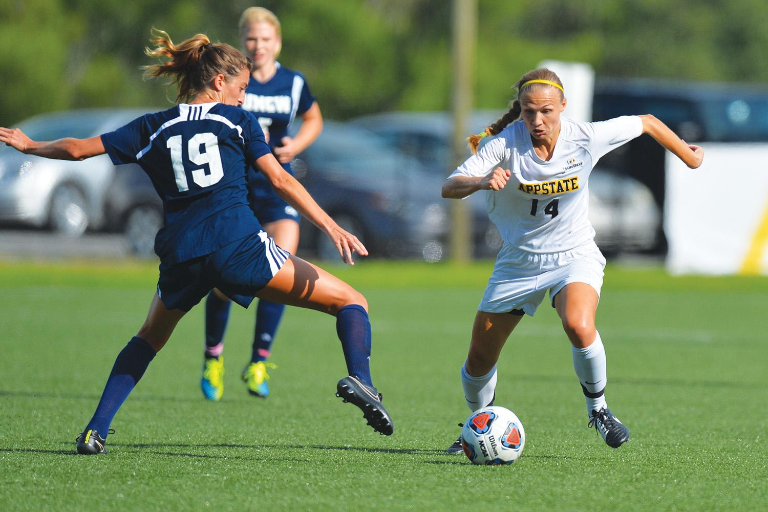 Senior+forward+Samantha+Childress+dribbles+around+the+defense+during+Friday%E2%80%99s+home+game+against+UNCW.+The+Mountaineers+scored+three+unanswered+second+half+goals+to+defeat+UNCW%2C+3-2.+Photo+courtesy+of+Tim+Cowie++%7C++Appalachian+State+Athletics