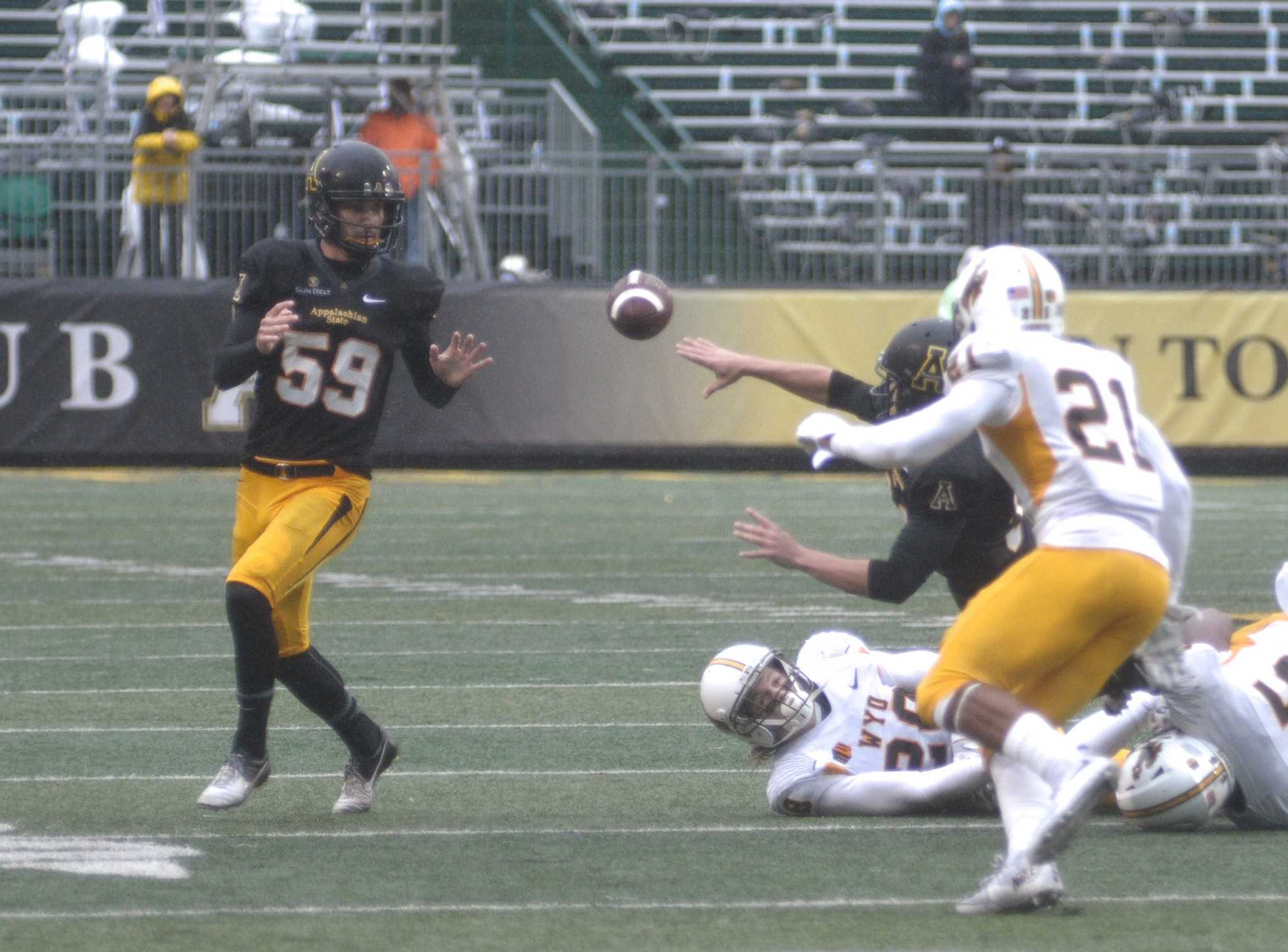 App+State+kicker+Zach+Matics+receives+a+pitch+on+a+fake+field+goal+attempt+in+the+second+quarter.+The+Mountaineers+defeated+Wyoming+31-13.
