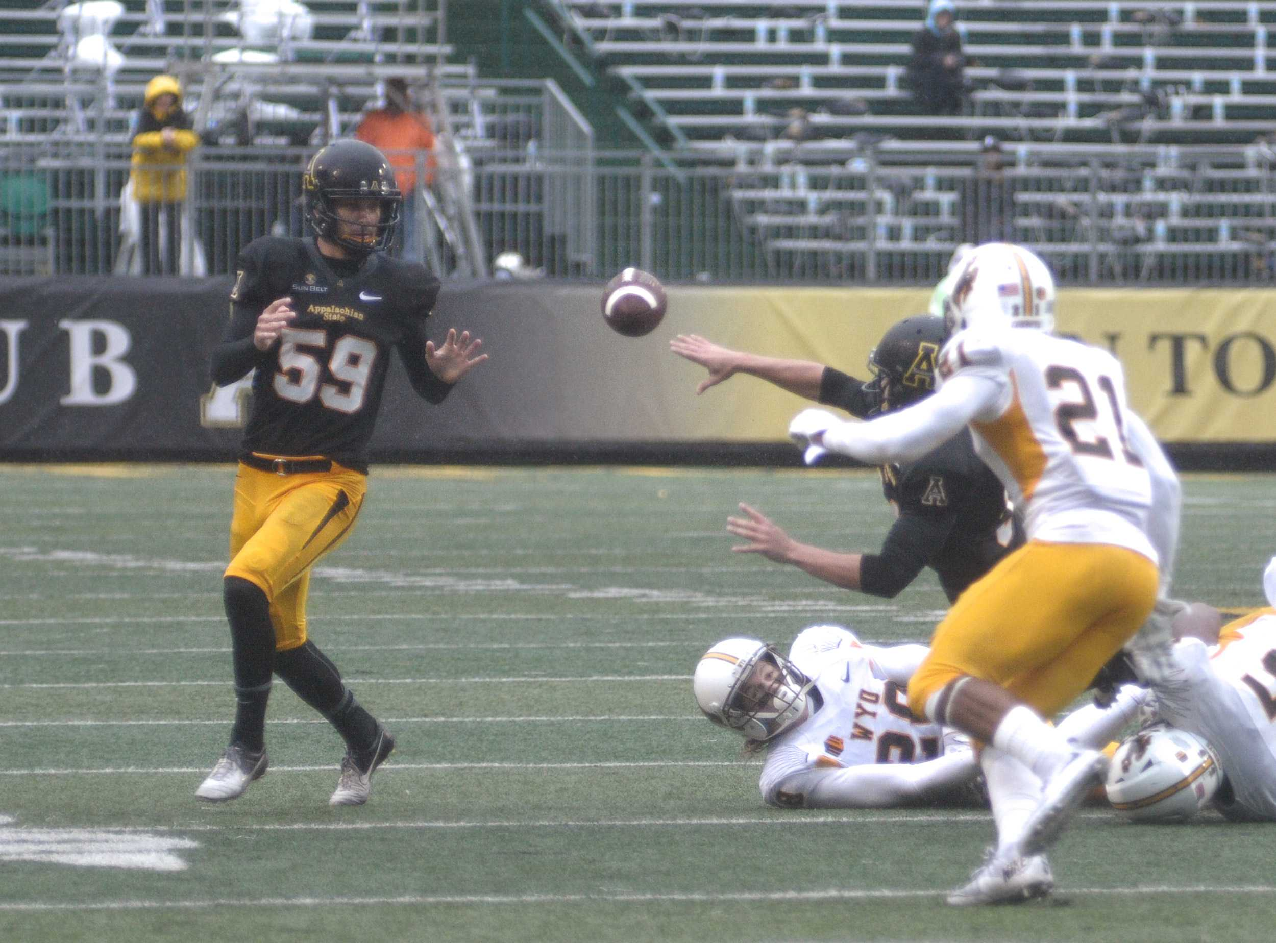 App State kicker Zach Matics receives a pitch on a fake field goal attempt in the second quarter. The Mountaineers defeated Wyoming 31-13.