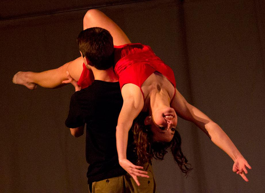 "Sophomore communication major Aliana Brown is lifted by freshman dance studies major Andrew Benson in their performance of ""high School Sweethearts"" Friday night at the Momentum Dance Festival held in the Varsity Gym Dance studio. The festival included 8 performances that showcased the talents of the Momentum Dance Club. Photo by Paul Heckert"