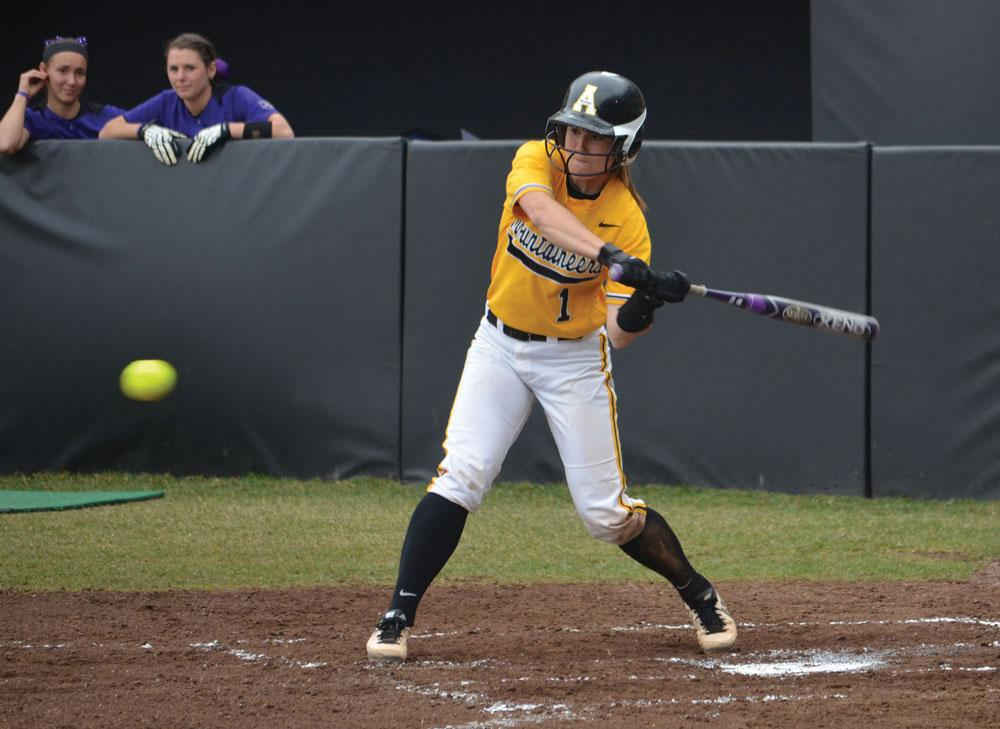 Junior catcher Sarah Warnock swings at a pitch during a home game against Western Carolina on Sunday afternoon. The Mountaineers won the series against the Catamounts 2-1.  Photo by Corey Spiers  |  The Appalachian