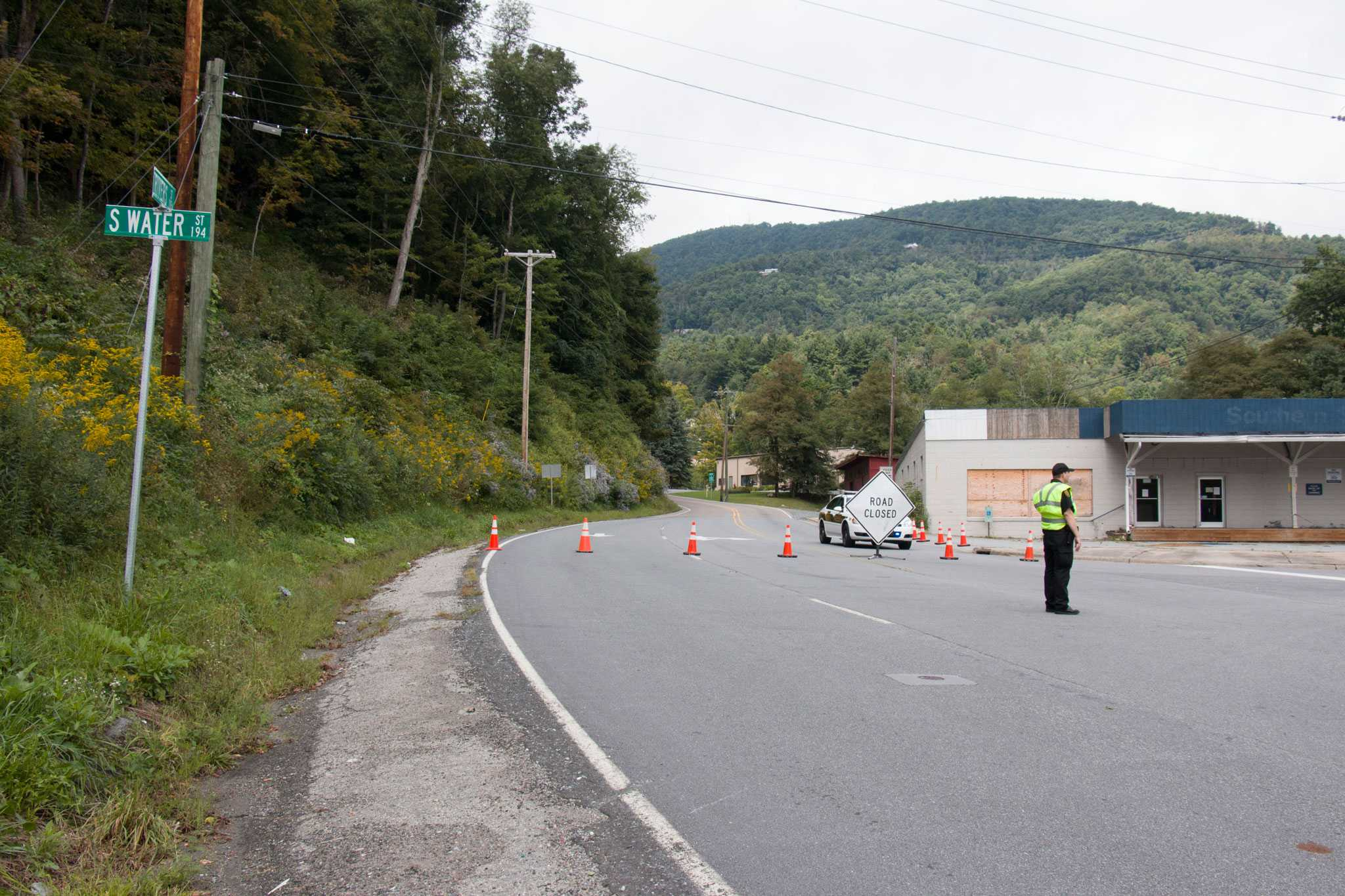 Officers stand by a roadblock on the intersection of South Water Street and Rivers Street where an unidentified body was found earlier today.  Photo by Chris Deverell  |  The Appalachian