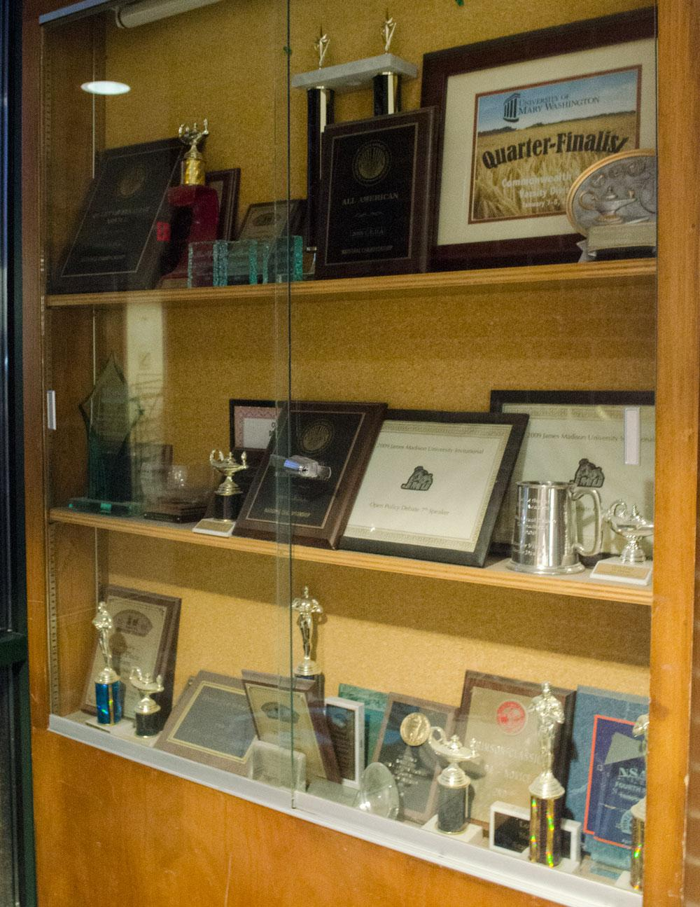 The trophy case for the debate team is on display in Walker Hall. Photo by Morgan Cook  |  The Appalachian