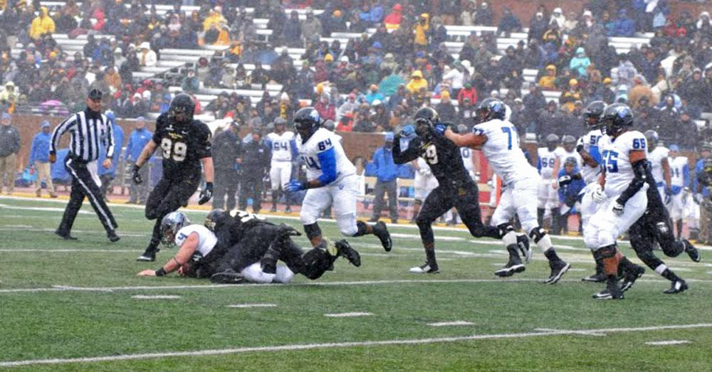 The Mountaineers battling the elements to claim a 44-0 win against Georgia State University at Kidd Brewer Stadium on Saturday. Photo by Cara Croom  |  The Appalachian