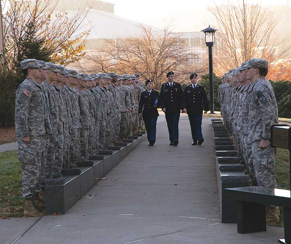 Cadets stand at attention for the Veteran's Day Memorial Service Tuesday morning on the west side of Dougherty Administration Building. Photo by Sarah Weiffenbach  |  The Appalachian
