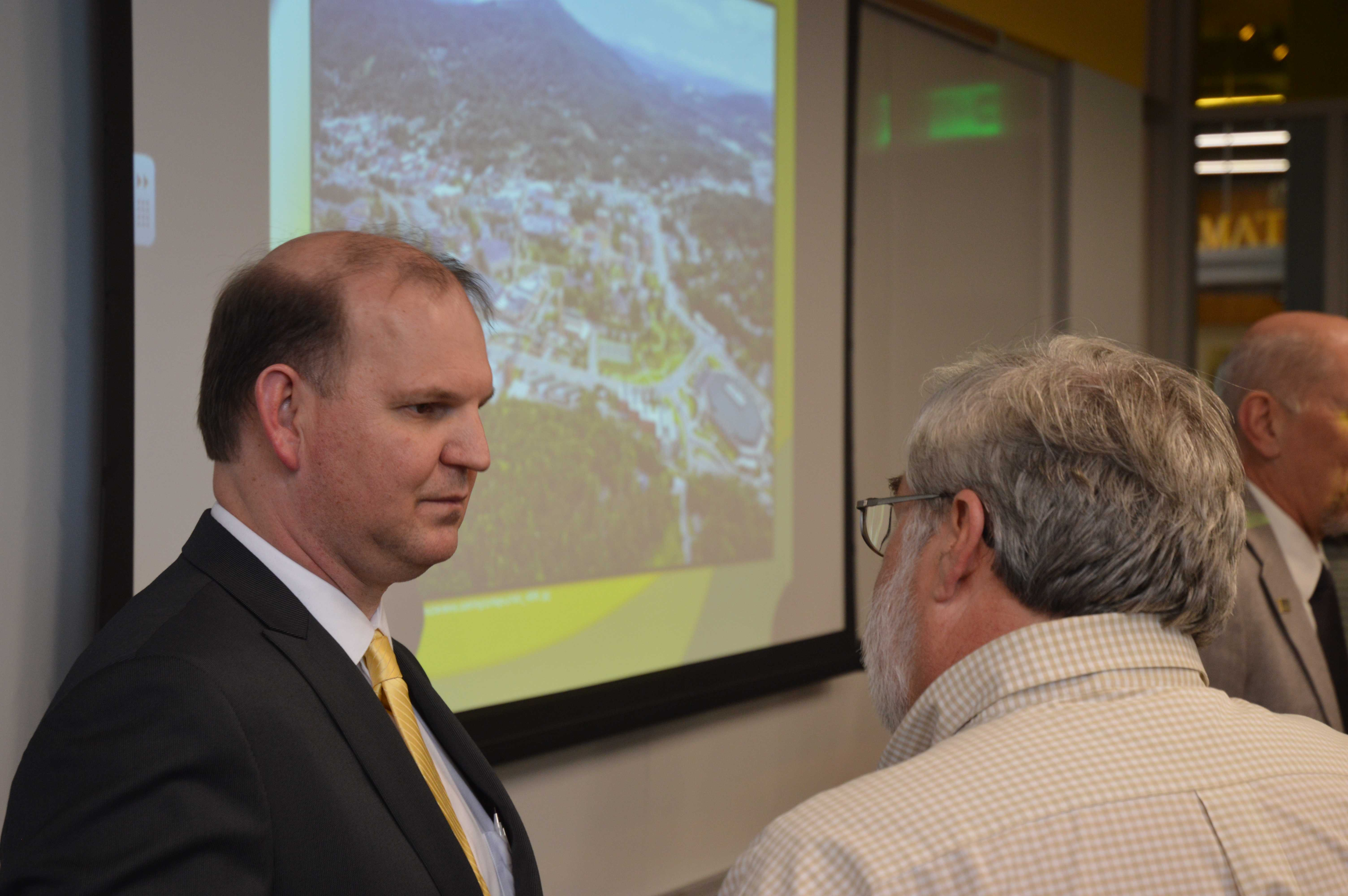 Darrell Kruger (left) speaks with an Appalachian State University faculty member after his open forum on Monday, March 16. Chancellor Sheri N. Everts announced on Wednesday that Kruger accepted the position offer and will effectively begin his tenure July 1, 2015.  Gerrit Van Genderen | The Appalachian
