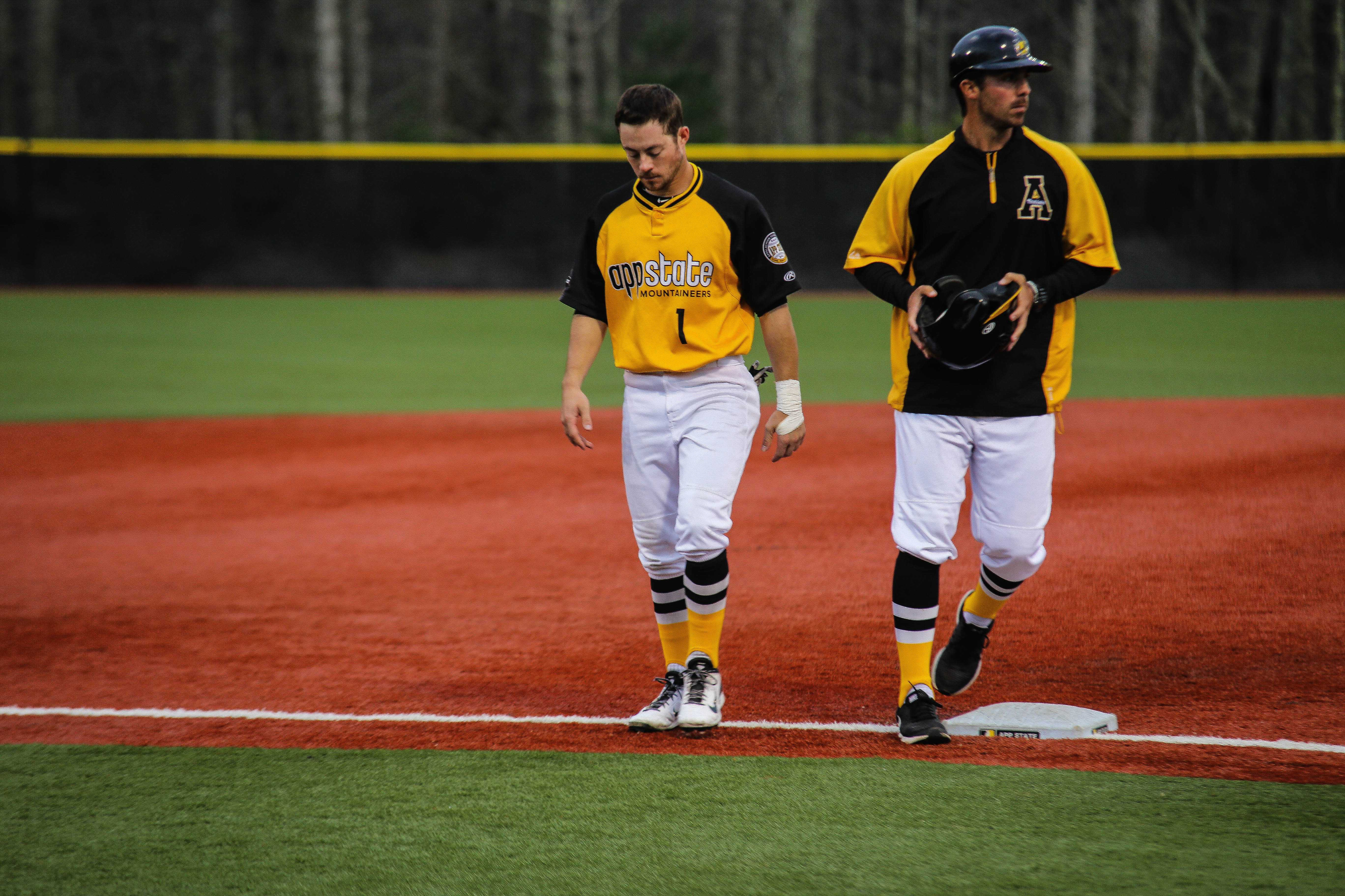 Junior outfielder Brandon Burris (left) walks off the field during App State's series opener against Georgia State. The Mountaineers had multiple defensive errors that resulted in a 4-3 loss in 12 innings. Photo: Gerrit Van Genderen | The Appalachian