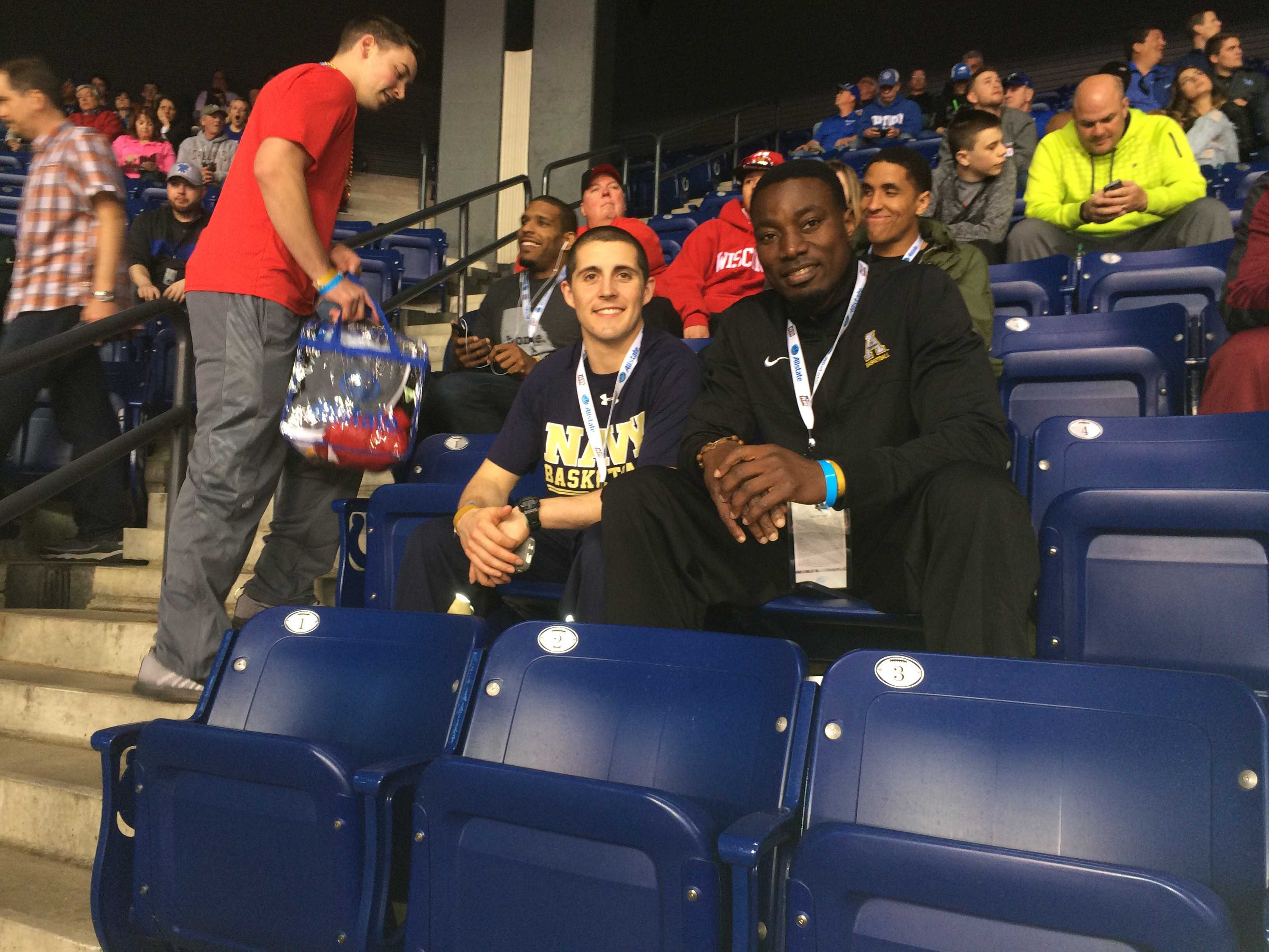 Michael Obacha (right) sits with U.S. Naval Academy Kevin Alter before the Michigan State-Duke Final Four game in Indianapolis, Indiana. Photo: Courtesy of App State Athletics