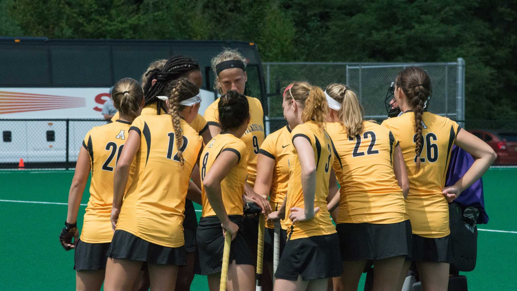The Appalachian State field hockey team huddles up before a match during the 2014-15 season. Under new coach Meghan Dawson, the team is 1-0 in exhibition play.