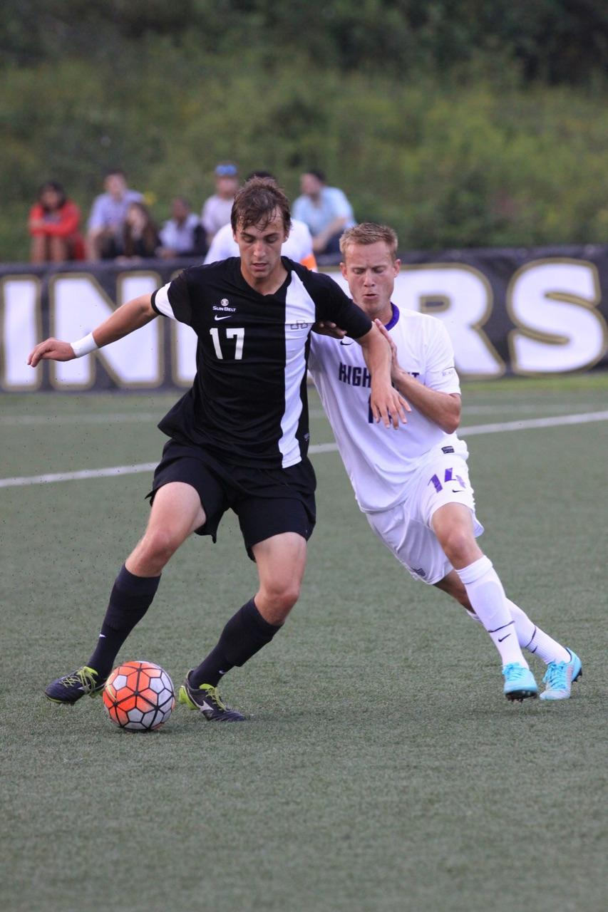 Senior+forward+Stephen+Chapman+dribbles+a+ball+past+the+defense+during+Saturday%27s+game+against+High+Point.+The+Mountaineers+defeated+the+Panther+5-1.+Photo+courtesy+of+Bill+McCarter.+