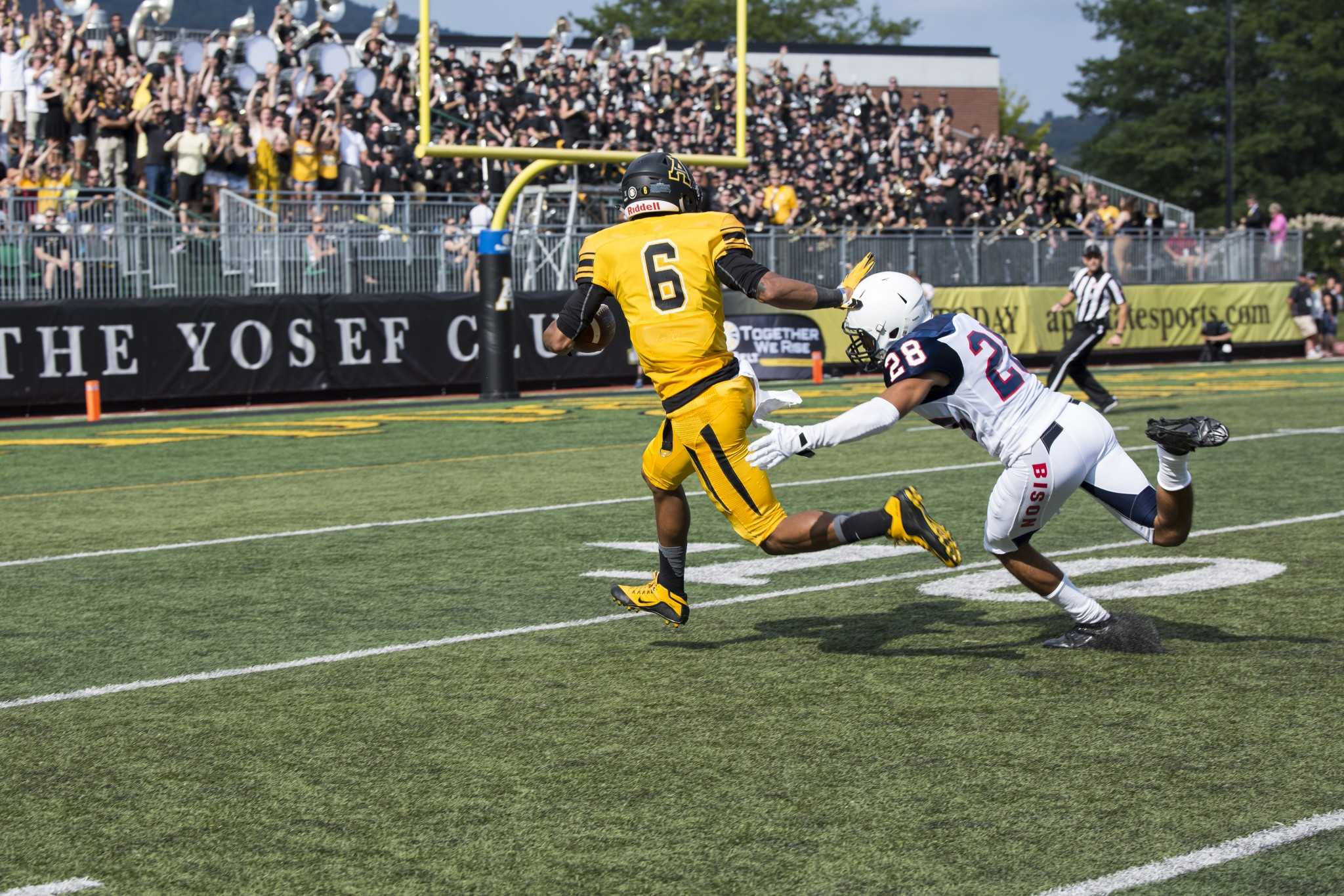 Sophomore+receiver+Shaedon+Meadors+breaks+free+of+a+tackle+en+route+to+a+Mountaineer+touchdown.+App+State+topped+Howard+49-0+in+their+season+opener.