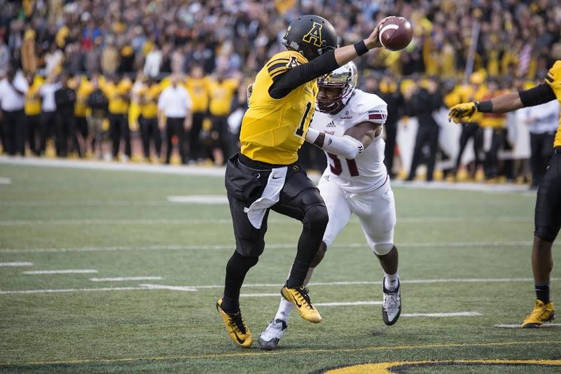Quarterback Taylor Lamb stretches the ball across the goal line to score his first of two rushing touchdowns against Troy. App State defeated the Trojans 44-41 in triple overtime.  Chris Deverell | The Appalachian