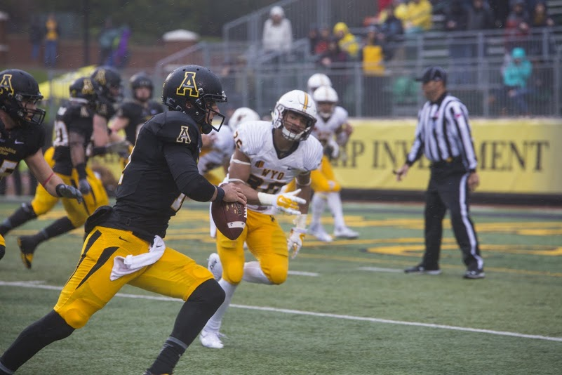App State quarterback Taylor Lamb scrambles towards the end zone Saturday against Wyoming. The Mountaineers defeated the Cowboys 31-13.