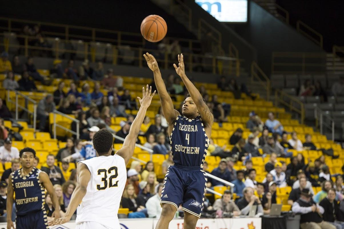 Georgia Southern freshman guard Tookie Brown hoists up a 3-pointer during Monday's 101-100 victory over Appalachian State. Brown finished the game with 34 points on 11 of 22 shooting.  Chris Deverell | The Appalachian
