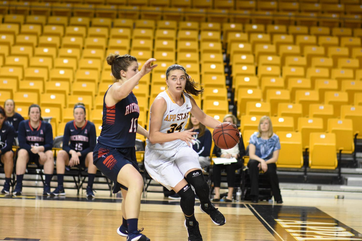 Madi Story drives to the basket against a Richmond defender. Story's offensive performance has made her a valuable asset to the mountaineers this season.