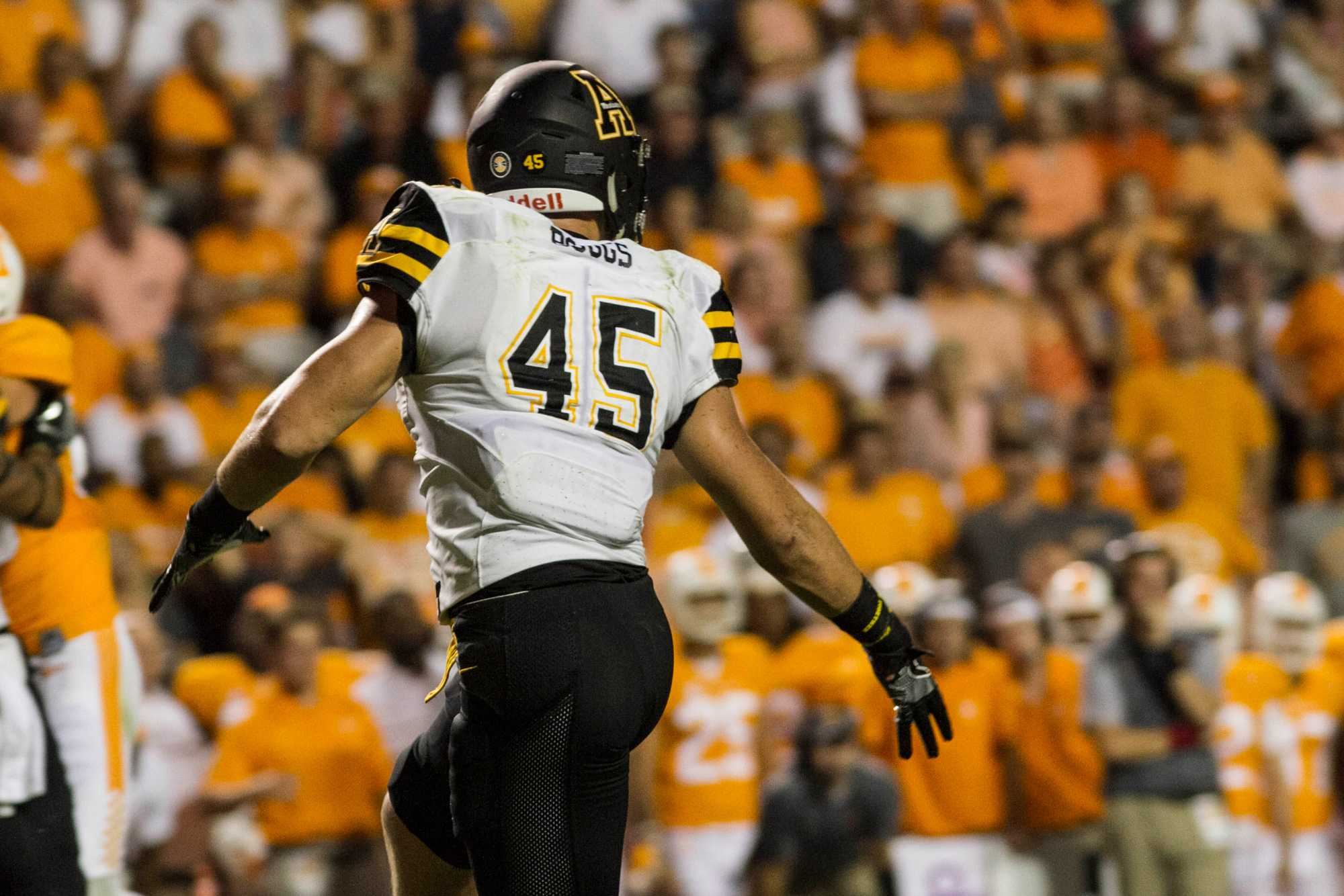 Inside+Linebacker%2C+Eric+Boggs%2C+looks+back+towards+his+teammates+during+the+game+against+Tennesse+in+2016.+The+Mountaineers+lost+the+away+game+in+overtime+with+the+final+score+being+20-13.