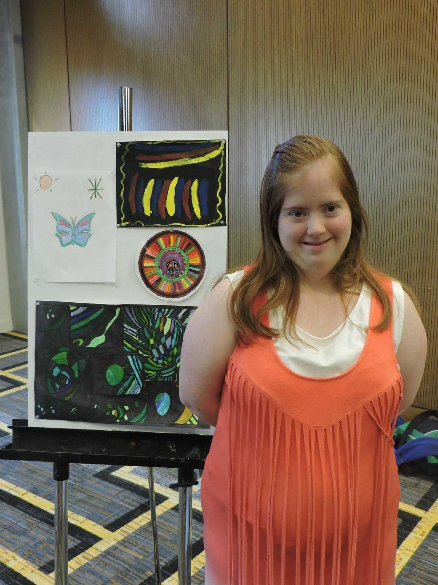 Moriah McKinney stands in front of her artwork on display during the ASNC Appalachian State Artist Showcase on Saturday night in Parkway Ballroom. McKinney's favorite piece is the butterfly drawing. Photo courtesy of Sydney Messer.