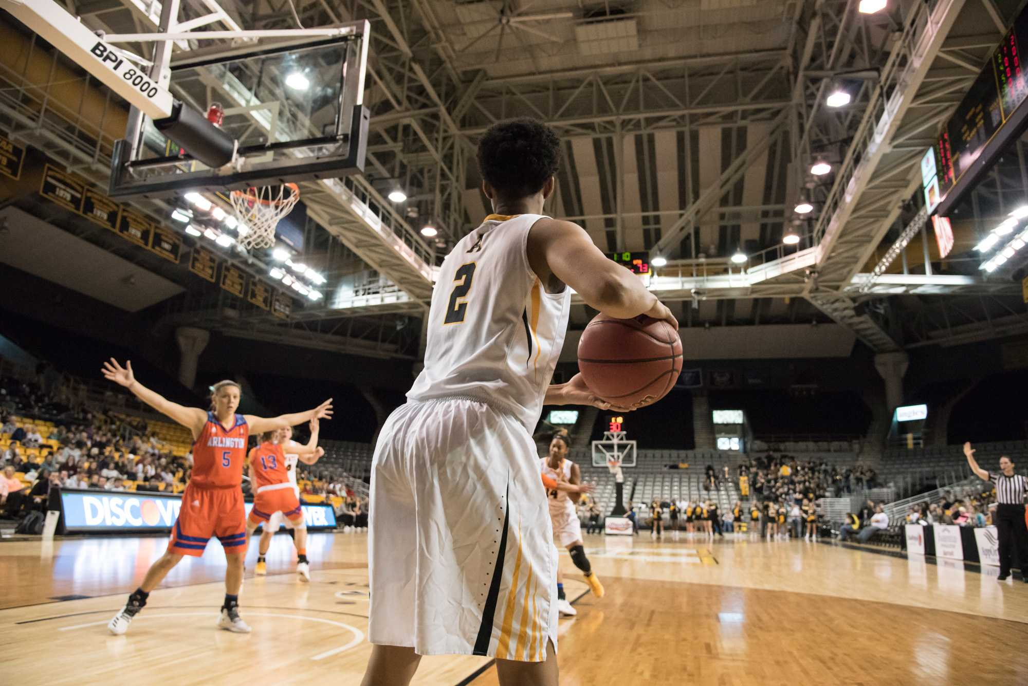 Sophomore guard Q. Murray, looks for an open player to pass to during the game against UT Arlington. The Mountaineers lost the the Mavericks with the final score being 62-73.