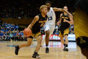 Sophomore Emarius Logan drives past Duke's Matt Jones