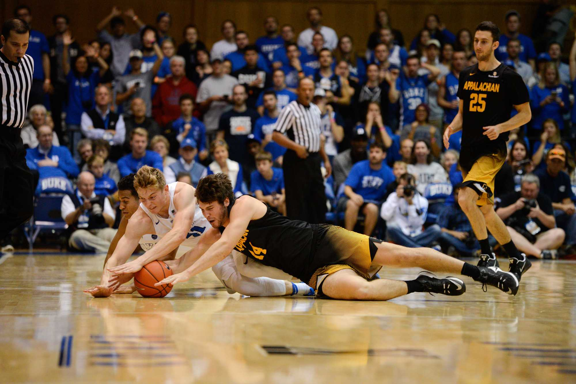 Sophomore  Bennett Holley fights for the ball with a Duke defender. App fell 93-58