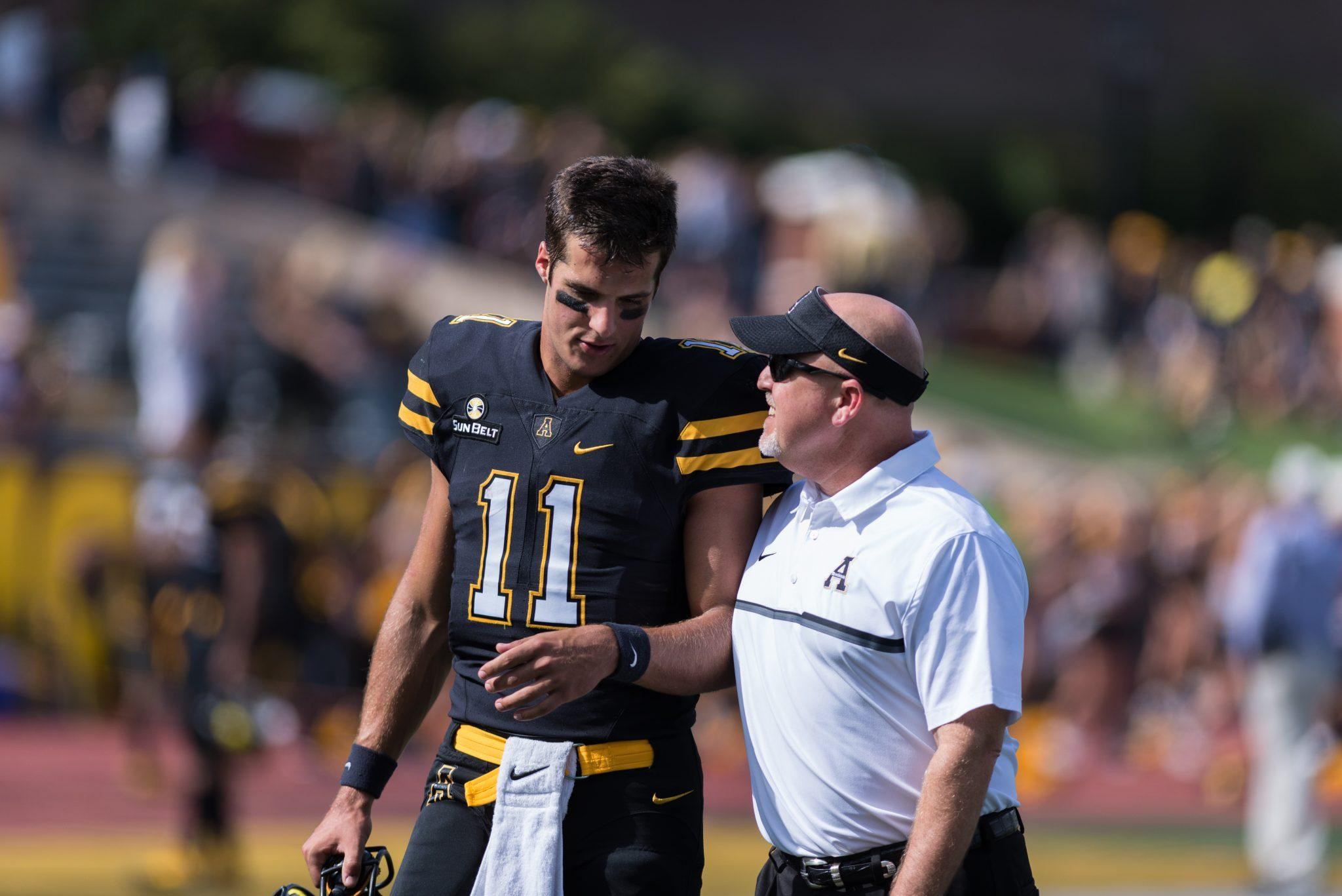 Quarterback Taylor Lamb with Secondary/Recruiting Coordinator Scot Sloan after the game against Georgia State. 17-3 (W). Photo by: Dallas Linger, Photo Editor