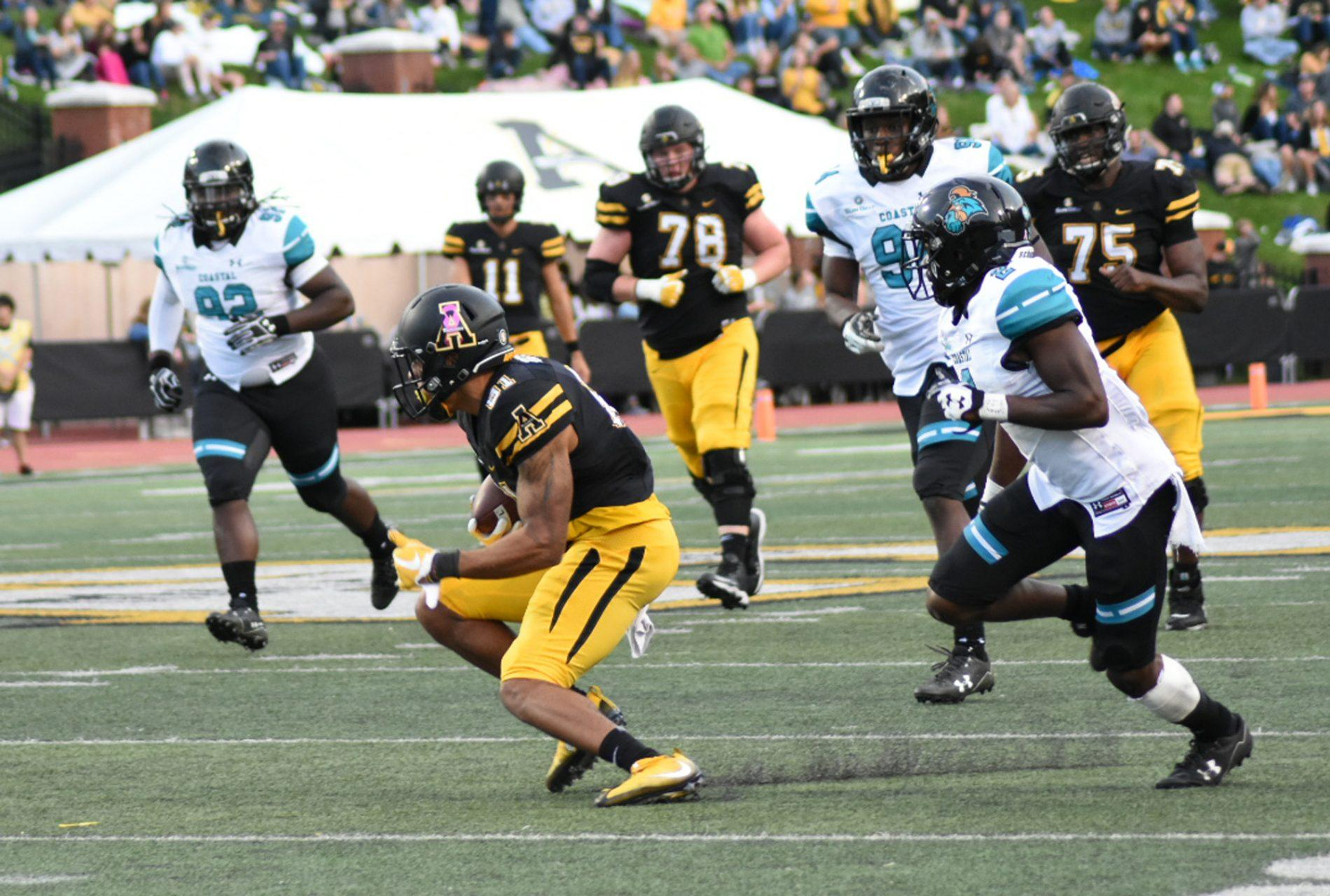 Wide+Receiver+Jalen+Virgil+catching+the+pass+against+the+Chanticleers.+Mountaineers+win+37+to+29.+