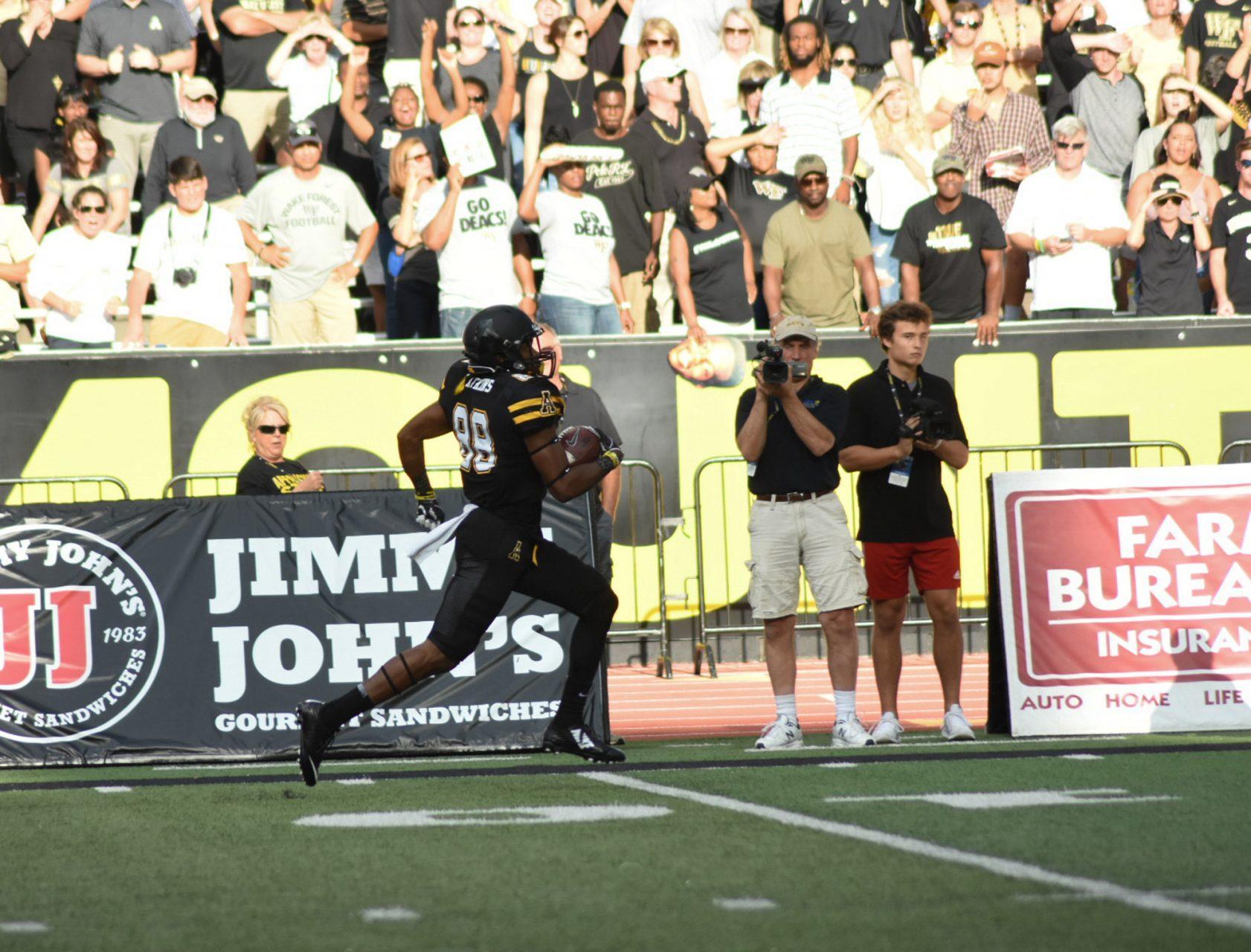 Junior+Wide+Receiver++TJ+Watkins+scoring+an+84-yard+catch+from+Taylor+Lamb.