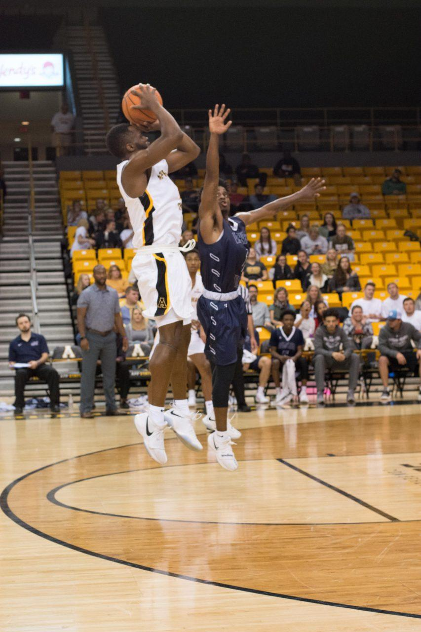Junior+Guard+Ronshad+Shabazz+shooting+a+mid-range+jump+shot+against+Warren+Wilson+Owls+at+the+Convocation+Center.+The+Mountaineers+won+125-71.