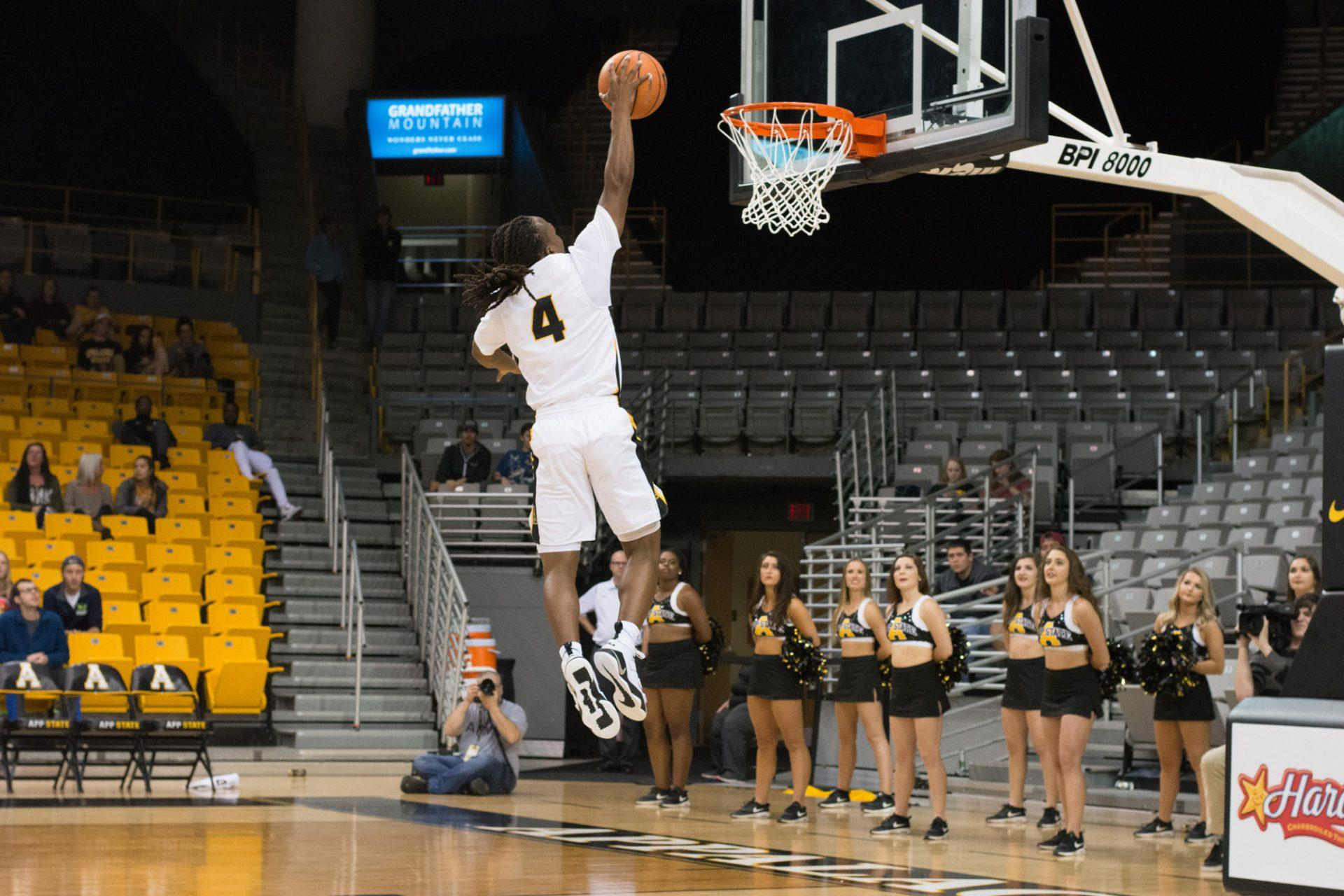 Sophomore Guard O'Showen Williams going up for the dunk against Warren Wilson Owls at the Convocation Center. The Mountaineers won 126-71.