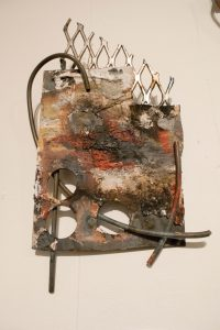 This piece was created by E Earl with steel and plaster. The art work is hanging up in Nth Gallery and was included in the New River Art Exhibit on February 3, 2017.