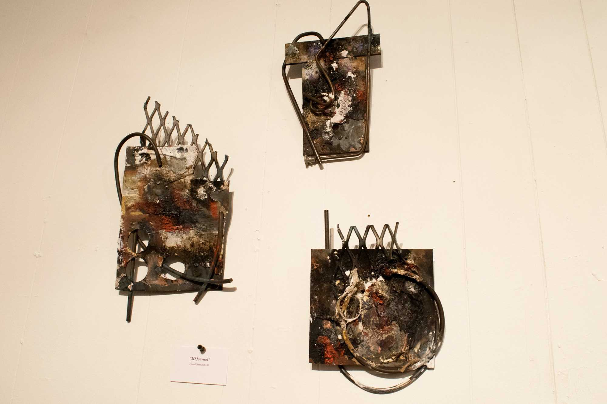 These pieces were created by E Earl with steel and plaster. The art work is hanging up in Nth Gallery and was included in the New River Art Exhibit on February 3, 2017.