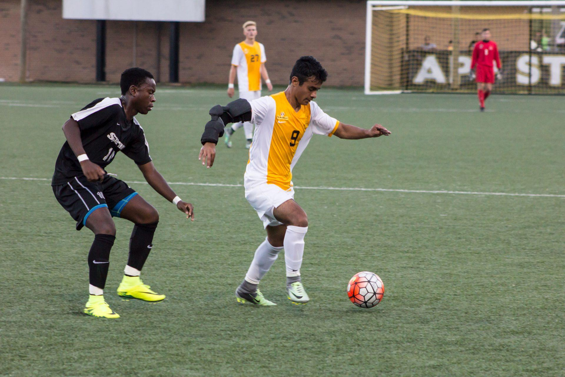 Junior Daniel Avila, kicks the ball while on offense during a 2016 season game against USC. The Mountaineers won with the final score being 3-1.
