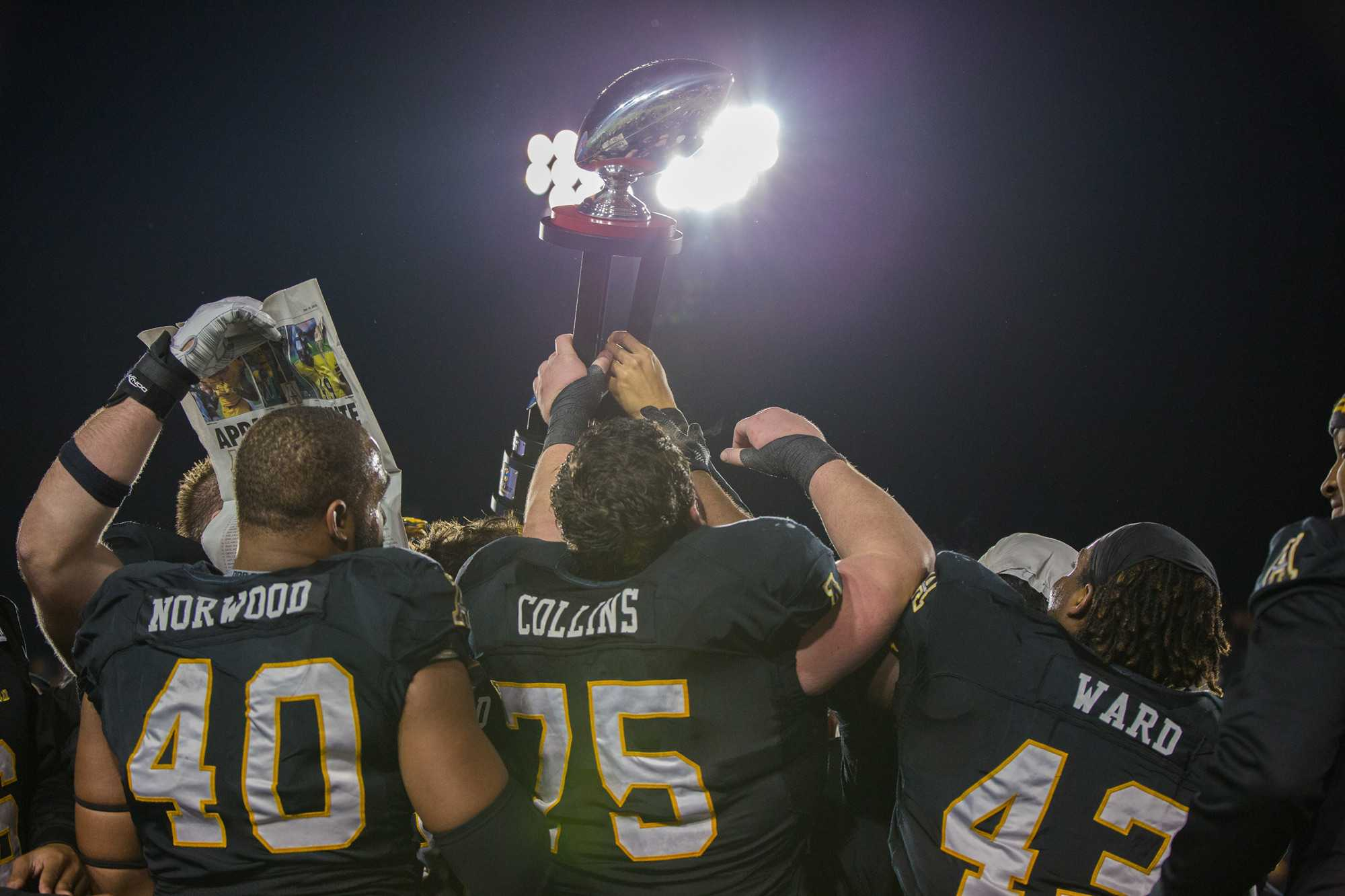 The Mountaineers celebrate after winning the Raycom Media Camellia Bowl. They defeated Ohio 31-29.