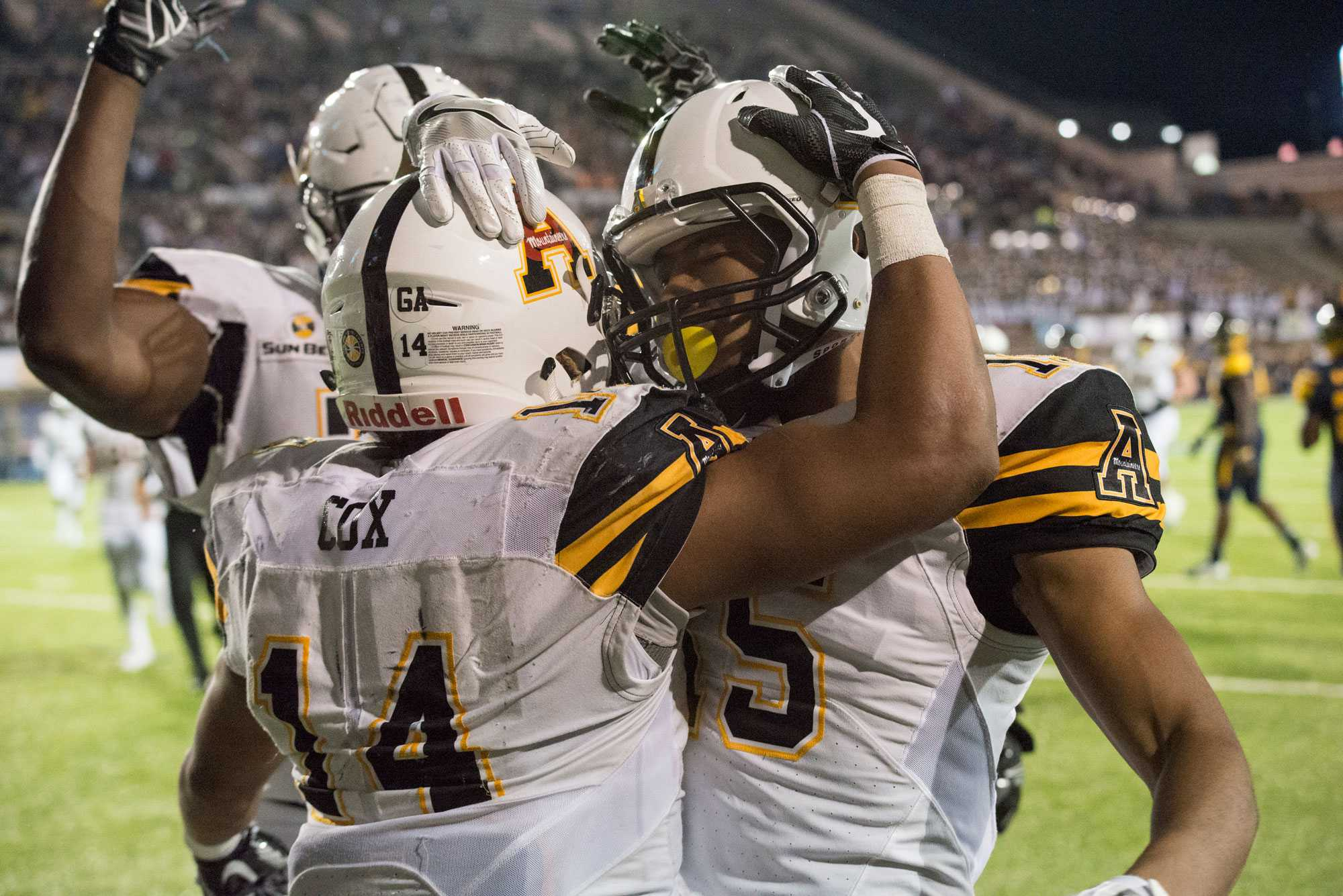 Senior Running Back, Marcus Cox, and freshman Wide Receiver, Mock Adams, celebrating the touchdown made by Cox at the game against Toledo at the Camellia Bowl in Montgomery, Alabama. The Mountaineers won the bowl game with the score being 31-28.   Photo by: Halle Keighton