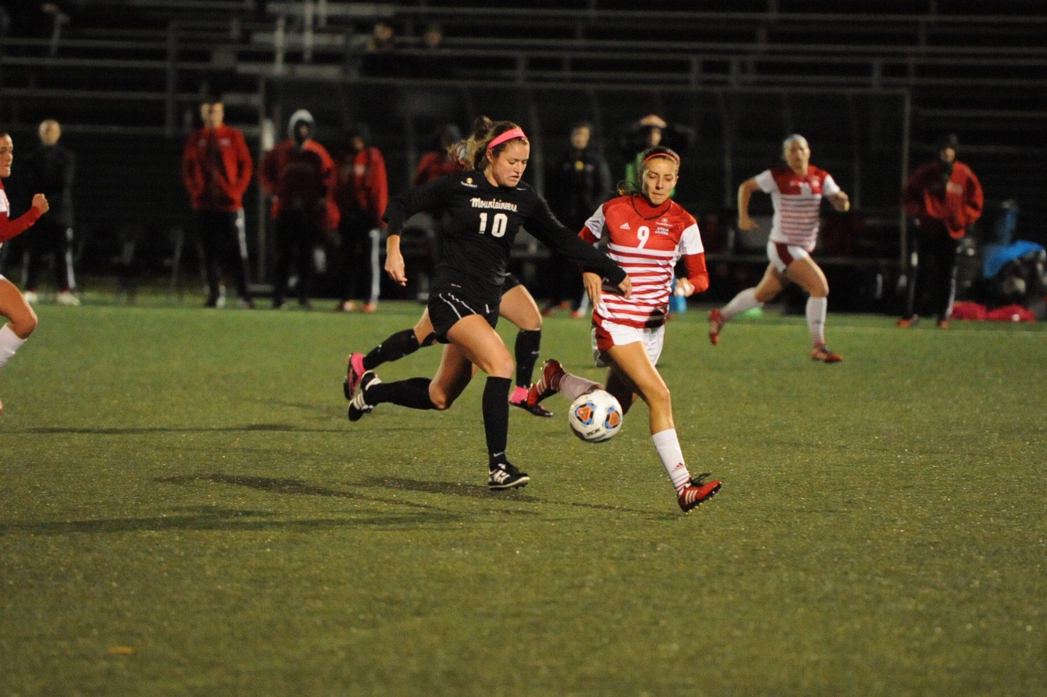 Senior Jane Cline drives the ball past a ULL defender during Friday night's win. Photo Courtesy: App State Athletics/Dave Mayo