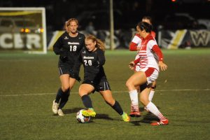 Junior Morgan Mosack dribbles through the defenders. Mosack finished the game with an assist and a shot. Photo Courtesy: App State Athletics/Dave Mayo