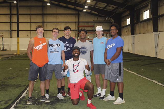 Dexter Jackson (center) poses for a photo with some of the athletes he works with at his Speed to Victory training program. Jackson hopes to continue working building Speed to Victory as a top training program in the country.