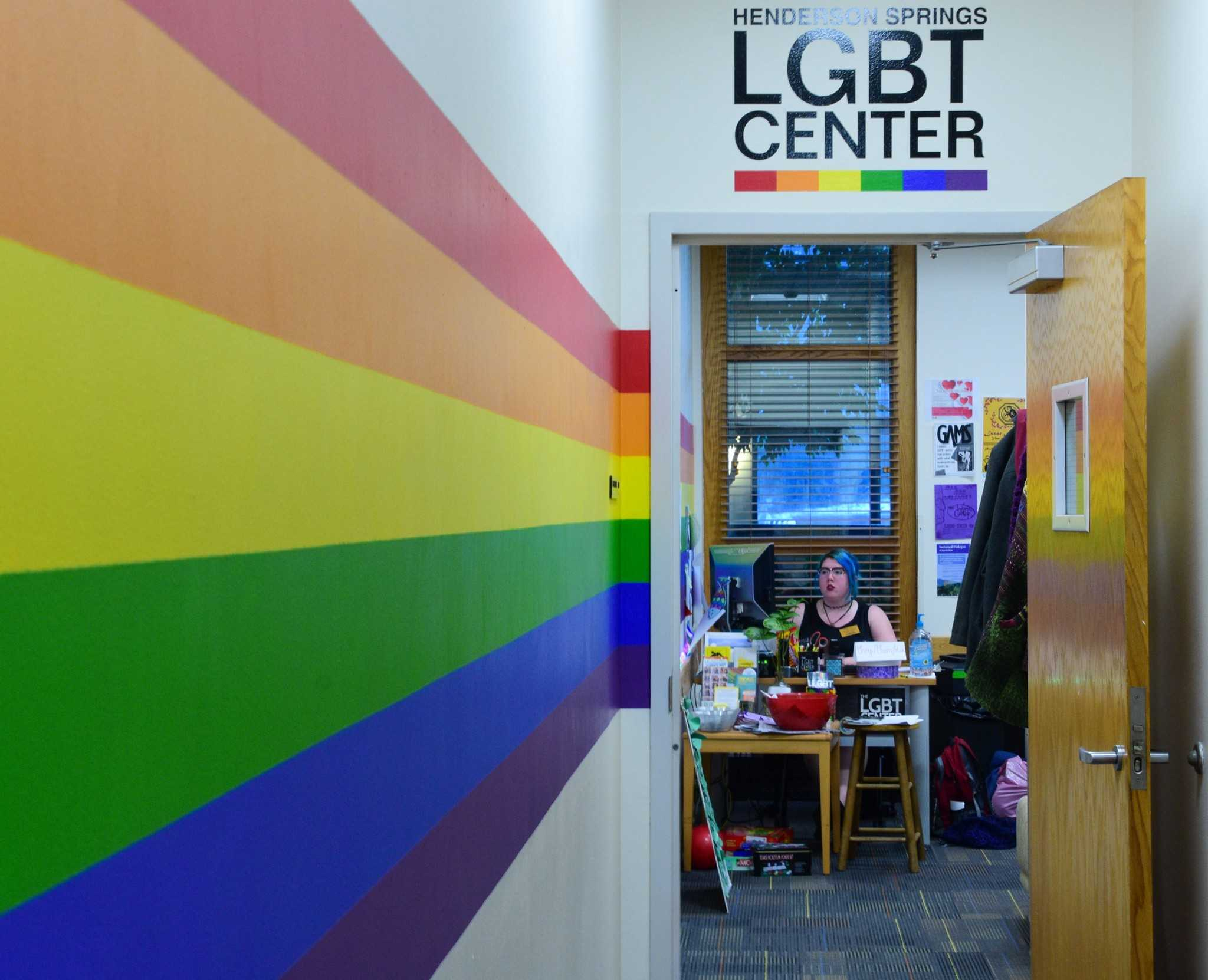 Paige Allen, junior English and secondary education major, runs a desk shift at the LGBT Center in Plemmons Student Union on Wednesday evening. Photo by Dallas Linger.