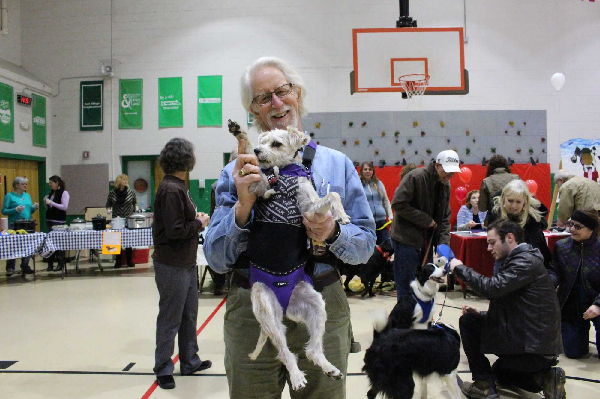 Owner Ben Henderson with dog Izzy (aka mischievous) who competed in the Cutest Dog and Best Wiggle Butt categories